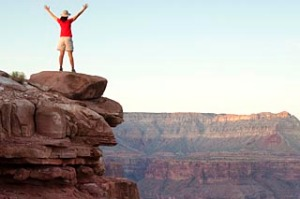 A woman standing on the rim of the Grand Canyon.