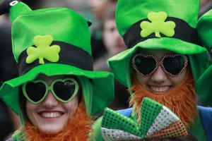 People dress in the emerald green to honour Ireland's Saint Patrick, as they enjoy the atmosphere during the St ...
