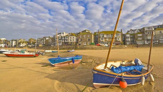 Sands of ages: Boats await the tide at St Ives.