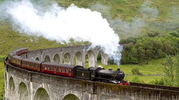 The Jacobite steam train crosses the Glenfinnan Viaduct at the head of Loch Shiel.