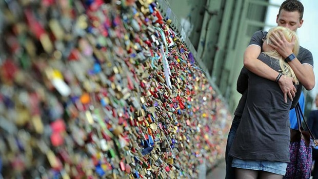 Too much affection: The weight of thousands of 'love locks' causes a 2.4-metre railing to collapse in the French capital.