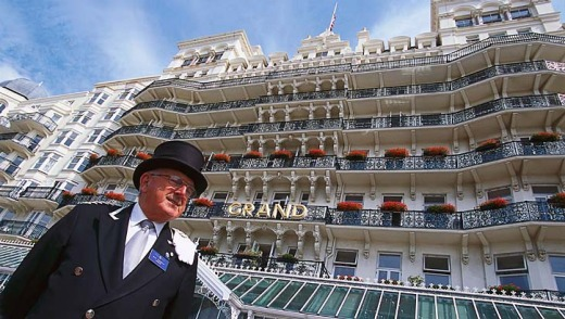 Concierge in front of the Grand Hotel.