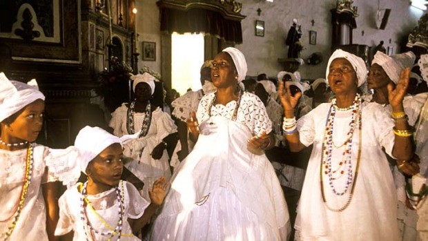 African flavour: Women celebrate the patron saint of Baiana do Acaraje in Pelorinho's church of Our Lady of the Rosaries.
