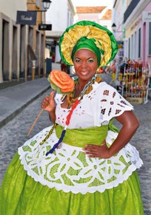 A woman in traditional Candomble dress in the historic centre of Salvador da Bahia.