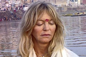 Hollywood actress Goldie Hawn, right, meditates in a boat in Varanasi, India, Monday, Nov. 9, 2009.
