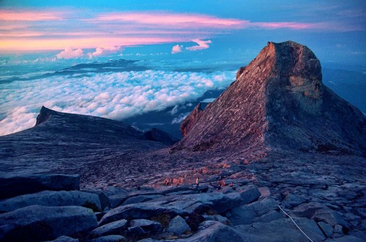 Climbing up Mt Kinabalu in Borneo as the sun rises.