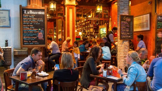 Dining buzz: Don't let waiters stick you in a corner (Seville, Spain).