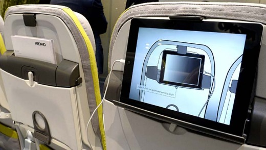 A tablet computer holder installed in the back of an airline seat on display during the Aircraft Interiors Expo in Hamburg.