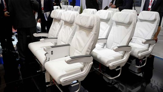 Rows of airline seats on displayed during the expo.