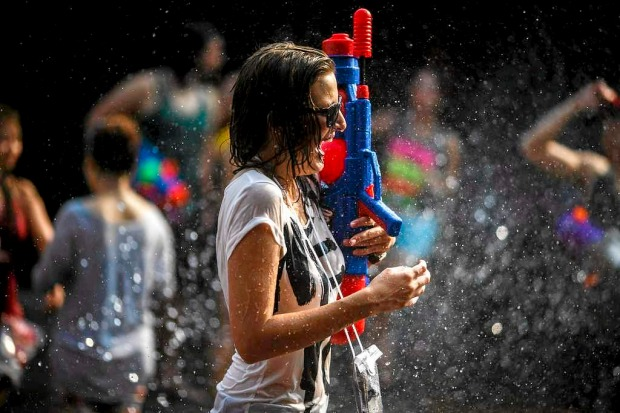The Songkran Festival's water fight is a good way to cool off in steamy Bangkok.