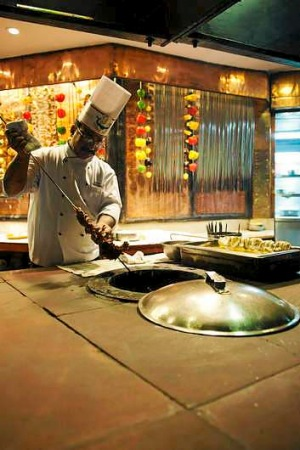 Cooking in the traditional tandoor oven at the Bukhara restaurant.