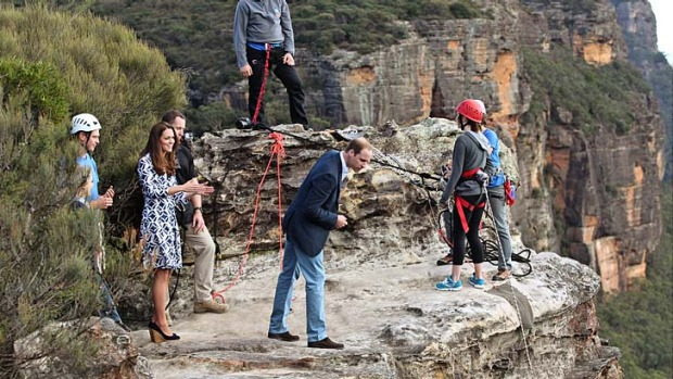 Long drop: The Duke and Duchess of Cambridge watch abseilers at Narrow Neck Lookout.