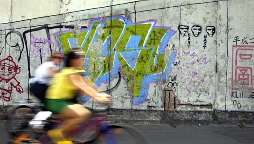 Graffiti streets makes Berlin a great city to explore on bicycles.