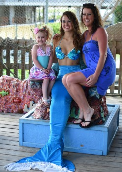 "'Mermaid' Katie waits poses for pictures with tourists following a performance of a underwater show ""Little Mermaid"" at ..."