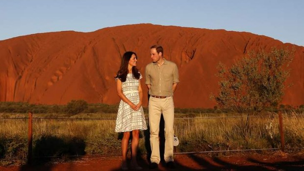 Britain's Prince William and his wife Catherine, Duchess of Cambridge, pose in front of Uluru.