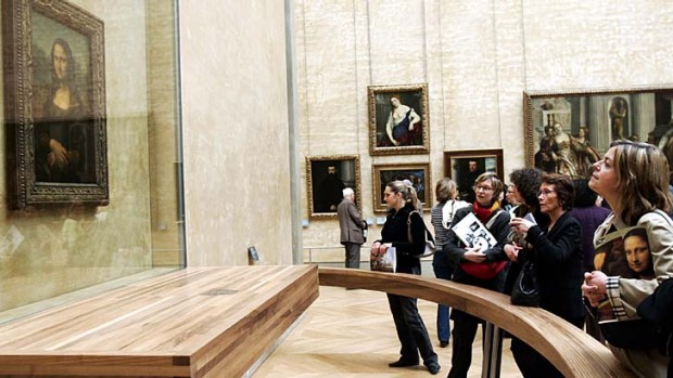 Visitors brace long queues at Paris' Louvre museum to see Leonardo Da Vinci's Mona Lisa.