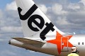 An airport worker stands in front of a Jetstar passenger plane at Avalon Airport in Melbourne.