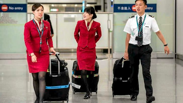 Cathay Pacific flight attendants want the Hong Kong airline to redesign their uniforms because they are too revealing and may provoke sexual harassment.