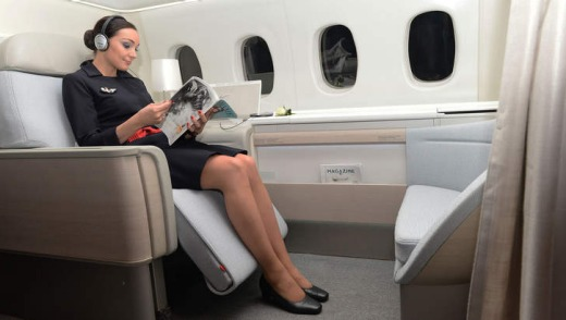 An Air France attendant shows off the airline's 'haute couture' suite.