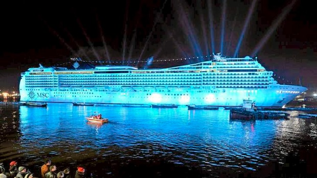 A lights show illuminates the night during the naming ceremony of cruise ship MSC Magnifica at the Hamburg harbour in 2010.