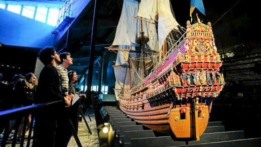 Visitors look at a model of the warship Vasa at the Vasamuseet museum in Stockholm, Sweden.