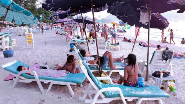 Tourists head to the beaches to avoid the political turmoil in Bangkok.