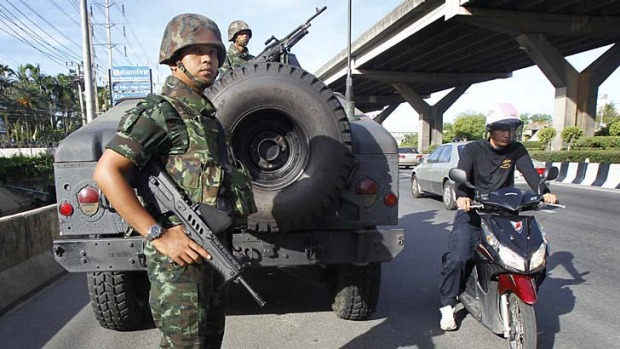 Thai soldiers take up a position on a main road in Bangkok after the army declared martial law on Tuesday.