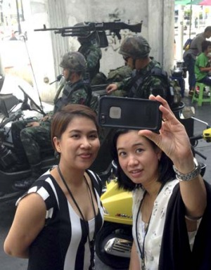 A selfie is taken at a military checkpoint in central Bangkok.