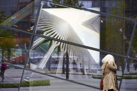 A woman looks in the windows of the National September 11 Memorial Museum.