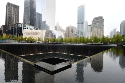 The National September 11 Memorial Museum with the north reflecting pool in foreground during the museum's dedication ...