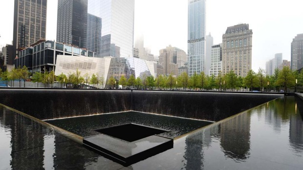 The National September 11 Memorial Museum with the north reflecting pool in foreground during the museum's dedication ceremony in New York on  May 15, 2014.