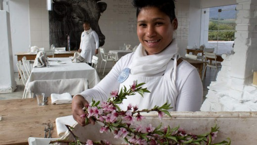 Organic oasis: a waitress brings in fresh blossoms for the tables at Babel Restaurant.