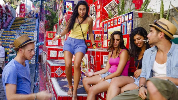 Cool and colourful: young locals sit on the famous Escadaria Selaron.