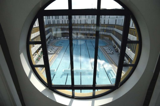 The famous Parisian Molitor public swimming pool which was closed 25 years ago and left in direpair and covered in ...