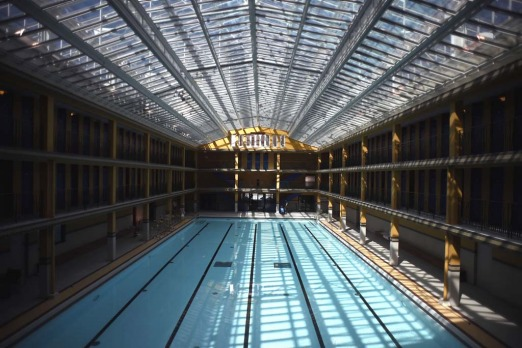 "The indoor pool and glass ceiling in the ""Molitor"" luxury resort with hotel, spa and restaurant in Paris."