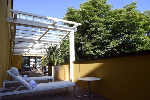 "The terrace on the side of a suite in the ""Molitor"" luxury resort with hotel, spa, swimming pool and restaurant in Paris."