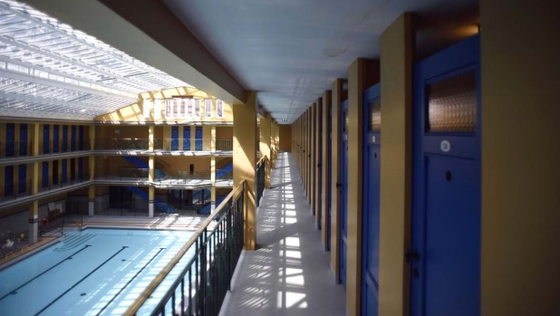 "Changing rooms on the side of an indoor pool in the ""Molitor"" luxury resort with hotel, spa and restaurant in Paris."