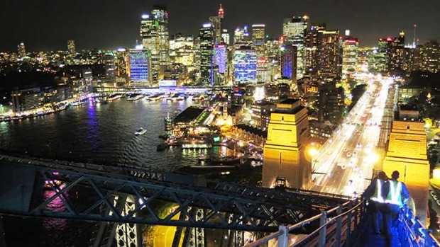 A view of Sydney's glittering lights from the top of Sydney Harbour Bridge.