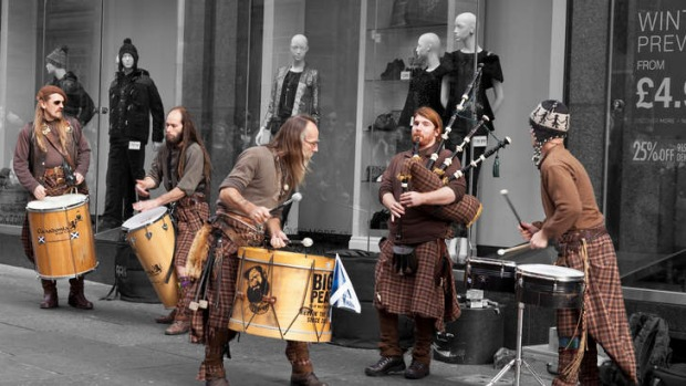 A different drum: Clanadonia, an updated Scottish traditional band, busks in Buchanan Street. Photo: Alamy