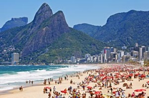 Colorful beach umbrellas and bathers on Ipanema beach, Rio de Janeiro, Brazil