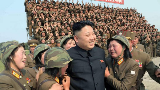 North Korean leader Kim Jong-Un smiling with female soldiers.