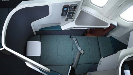 The business class seat nestles within its own angled pod.