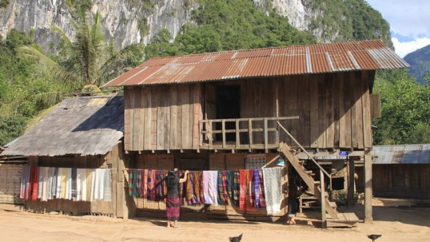 Village life: Ban Sopjam, population 200, nestles under limestone cliffs in northern Laos.