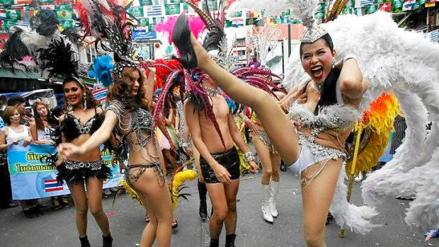 Dancers perform during a celebration to boost tourism in Bangkok.