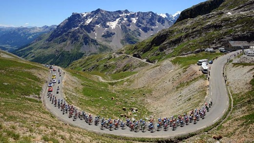 The grind: The pack climbs the Col du Galibier during the Tour de France stage between Embrun and L'Alpe d'Huez.