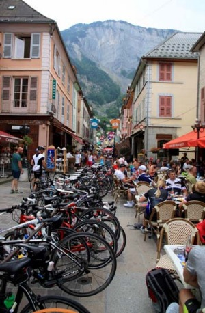 Rest point at at Bourg d'Oisans: Cyclists enjoying a rest before a steep climb in the French Alps.