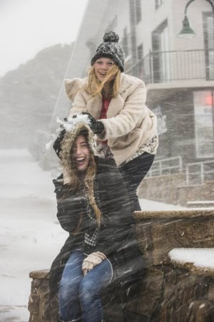 Terry Saggers (below) and Hannah Bowes enjoy the fresh snow that fell on Mt Buller today.
