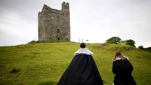 <em>Game of Thrones</em> tourists visit Audleys field and castle, Castle Ward, Strangford Lough in Northern Ireland. Audleys field and castle was used for filming King Robert Baratheon and his retinue arrive at Winterfell in season one.