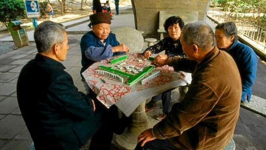 Playing mahjong is a popular pastime in Guangzhou.