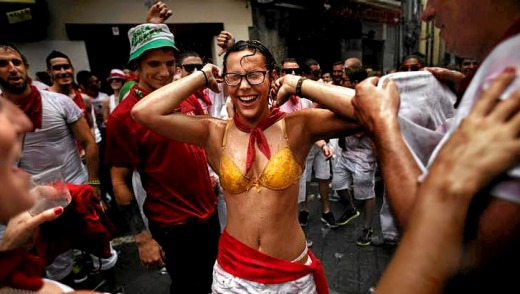 Revellers celebrate the official opening of the 2014 San Fermin fiestas, in Pamplona, Spain.
